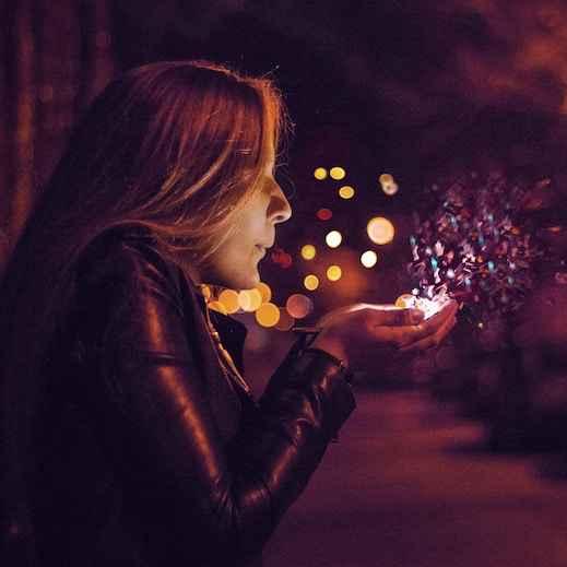 woman blows sparkles.jpg