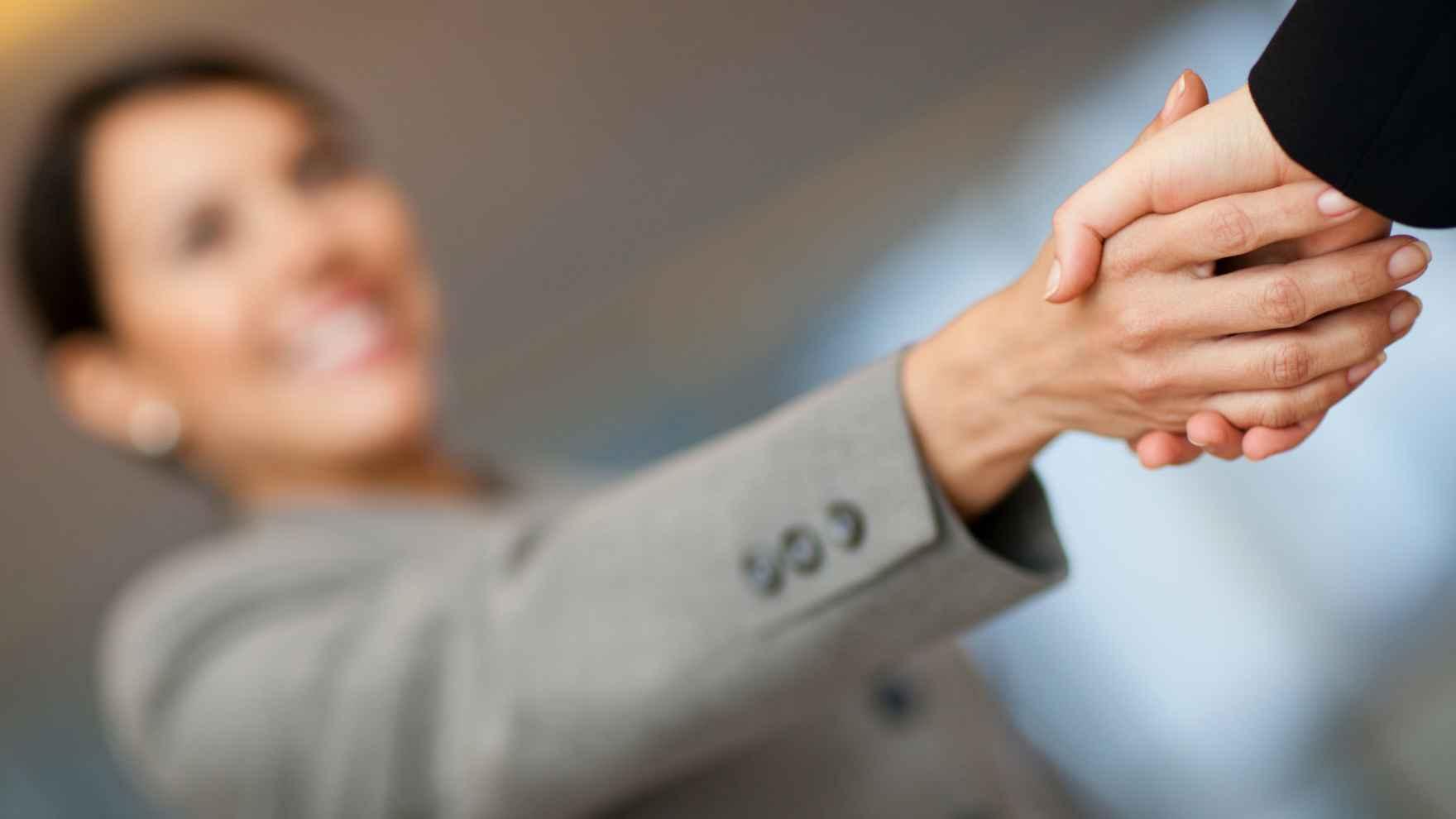 woman handshake.jpg