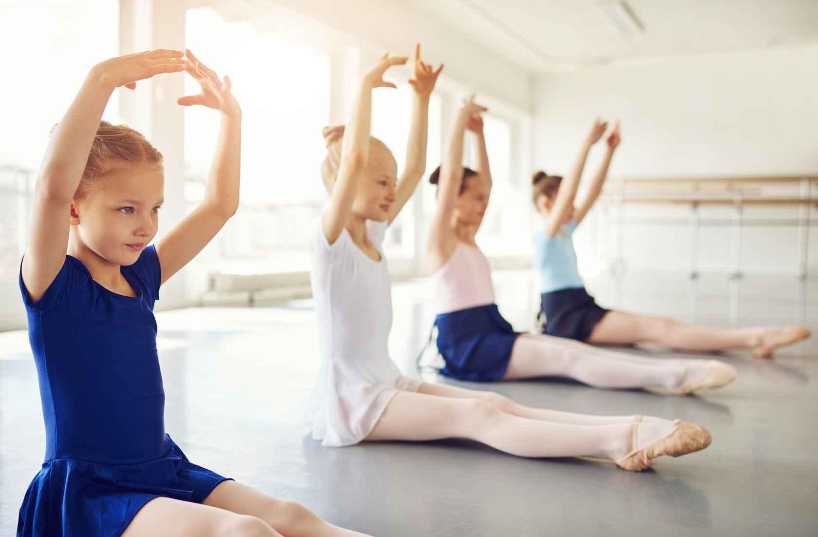 ballet-dancing-children-with-hands-up-sitting-in-SVPWQHZ.jpg