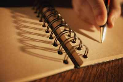 Wire Bound Notebook and Pen Writing