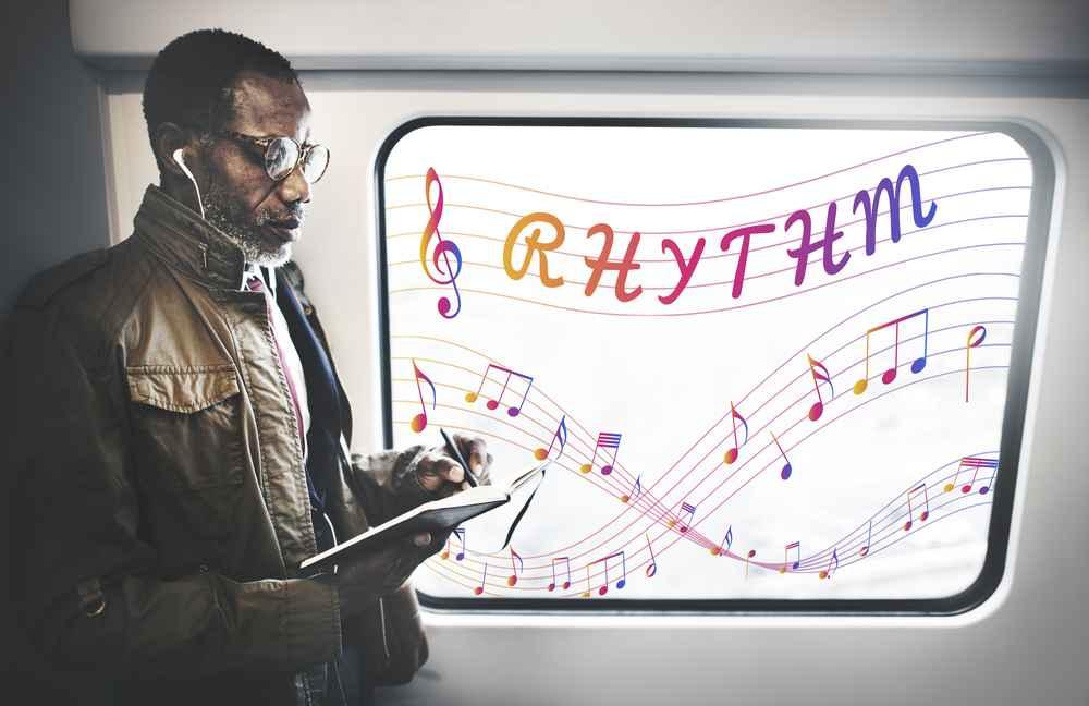 Rythm - Businessman in train, against window