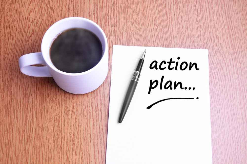 Coffee, pen and notes write action plan