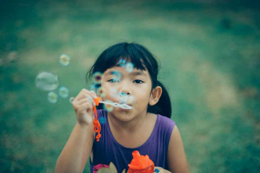 girl-blowing-bubbles-900x600.jpg
