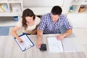 bigstock-Couple-Calculating-Bills-64915012-300x200.jpg