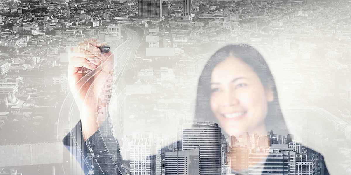Double-Exposure-of-Business-Woman-and-City.jpg