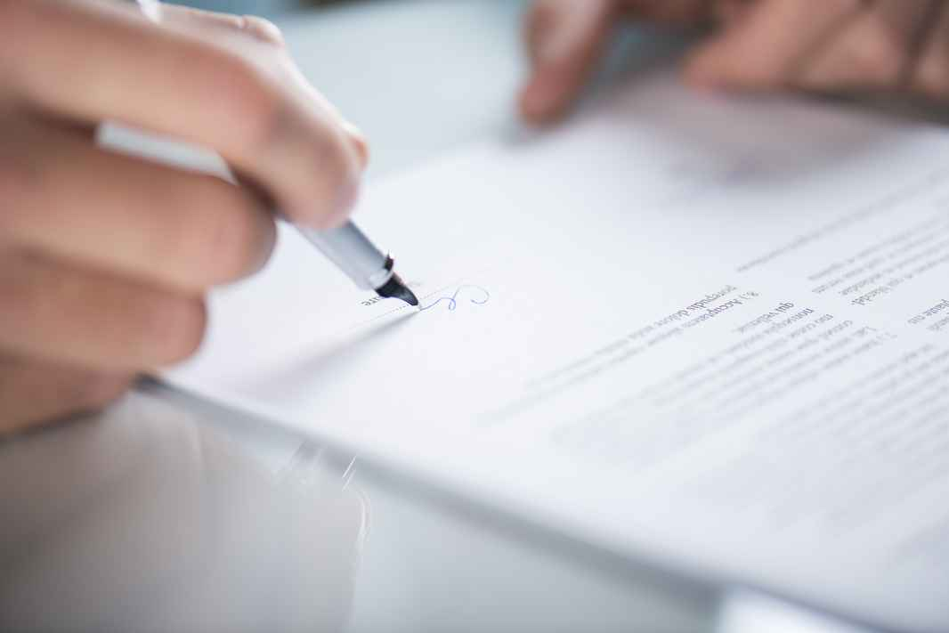 graphicstock-businessman-is-signing-a-contract-business-contract-details_SAJ_O09bW