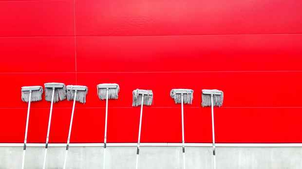 red wall and white mops