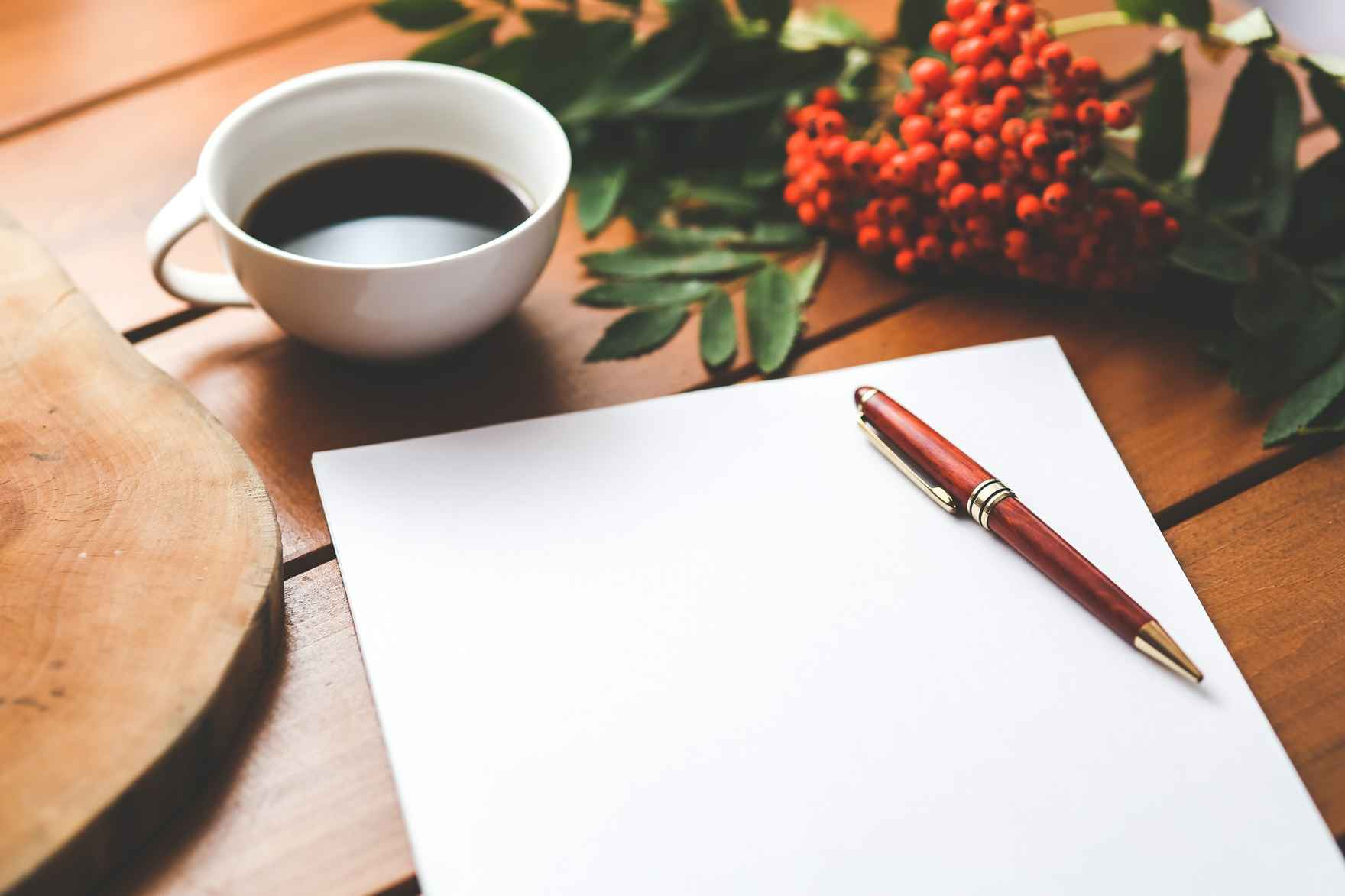 blank-paper-with-pen-and-coffee-cup-on-wood-table-6357.jpg