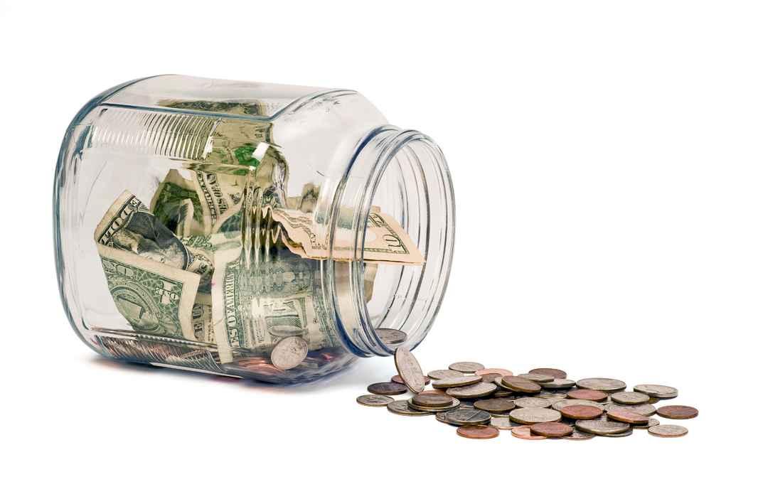 money-jar-spill-on-white-background_SFv8h664j
