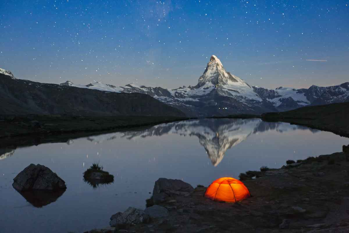 Loneley-Tent-under-stary-sky-at-Matterhorn-656115460_5760x3840