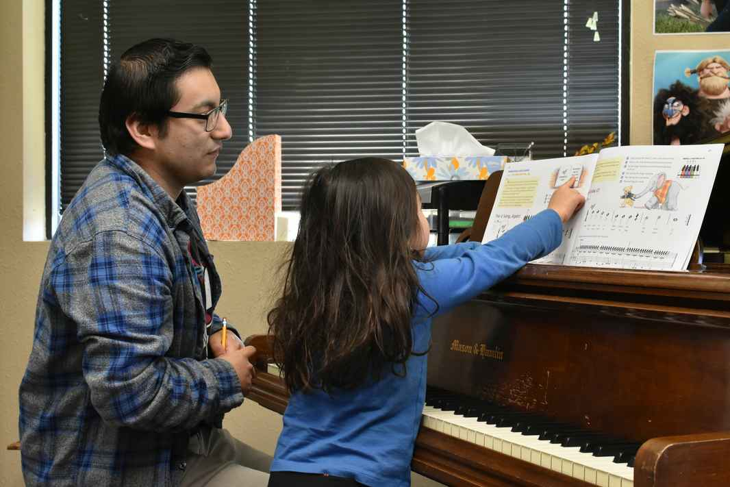 Juan Gonzalez piano teacher during lessons