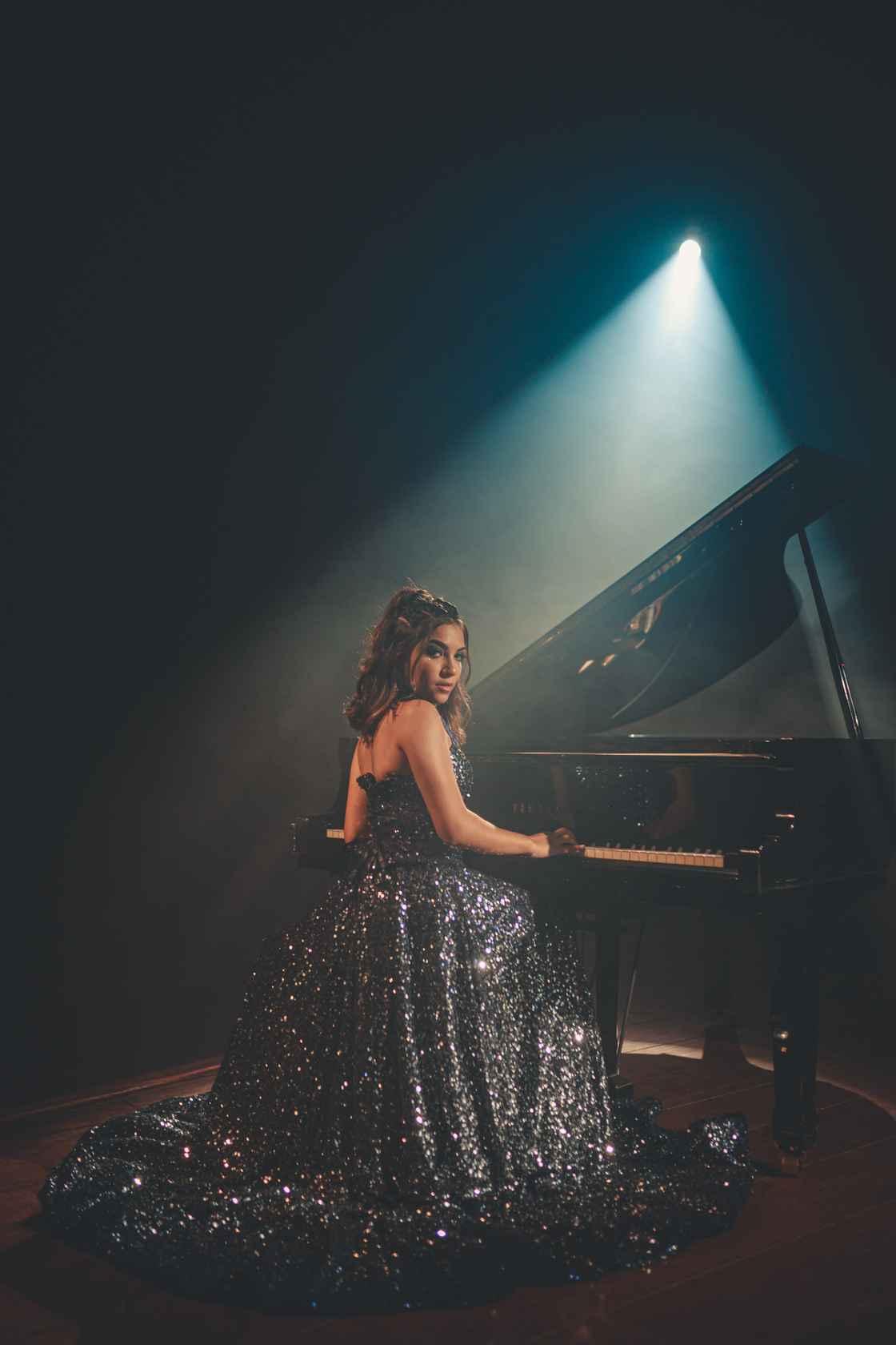 woman-sitting-near-piano-3778702.jpg