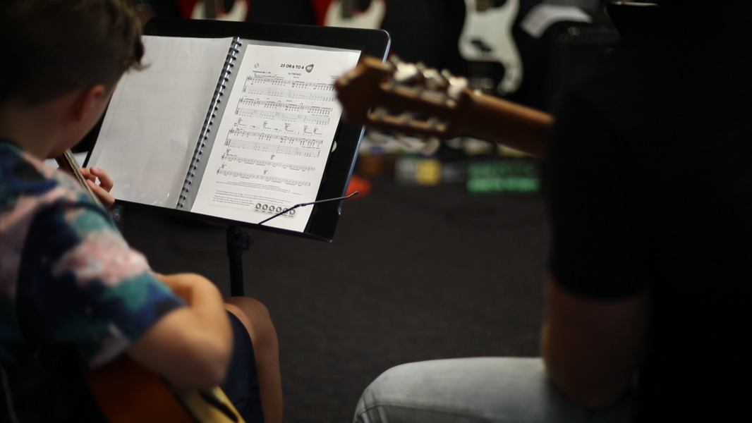 reading music together during guitar lessons