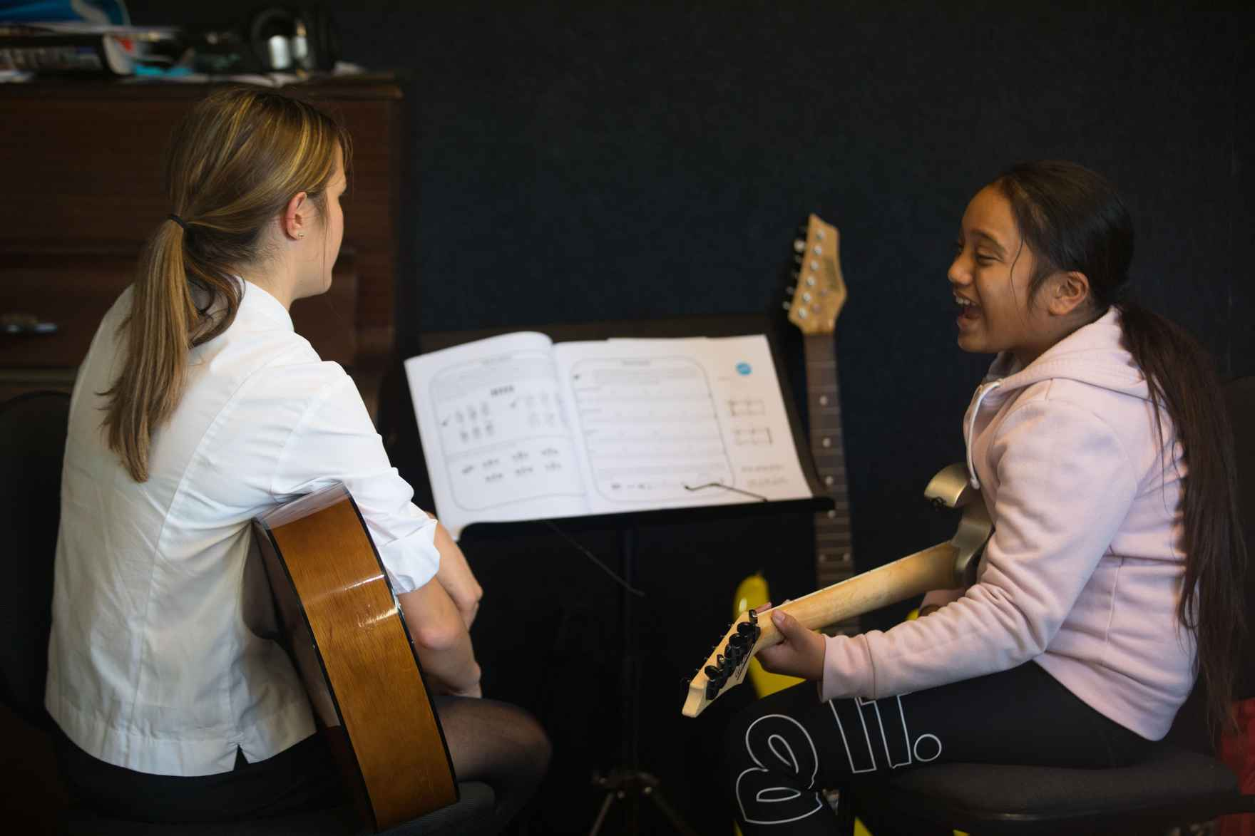 practicing the guitar together