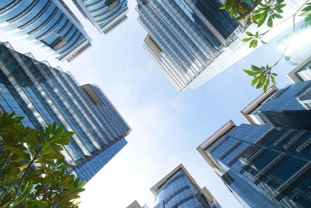 graphicstock-common-modern-business-skyscrapers-high-rise-buildings-architecture-raising-to-the-sky-sun-concepts-of-financial-economics-future-etc_BuAeYsvgie