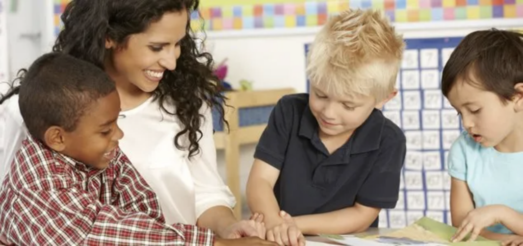 tutors helping kids to learn to read