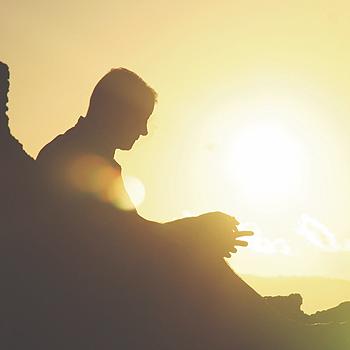 man-sitting-sunset_350x350