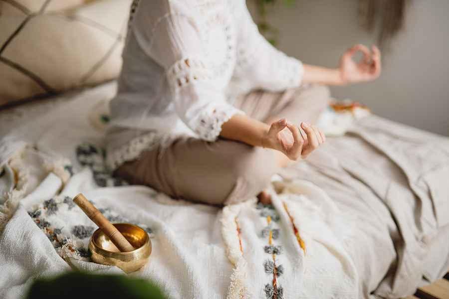 bigstock-Cropped-View-Of-Woman-Meditati-404465444