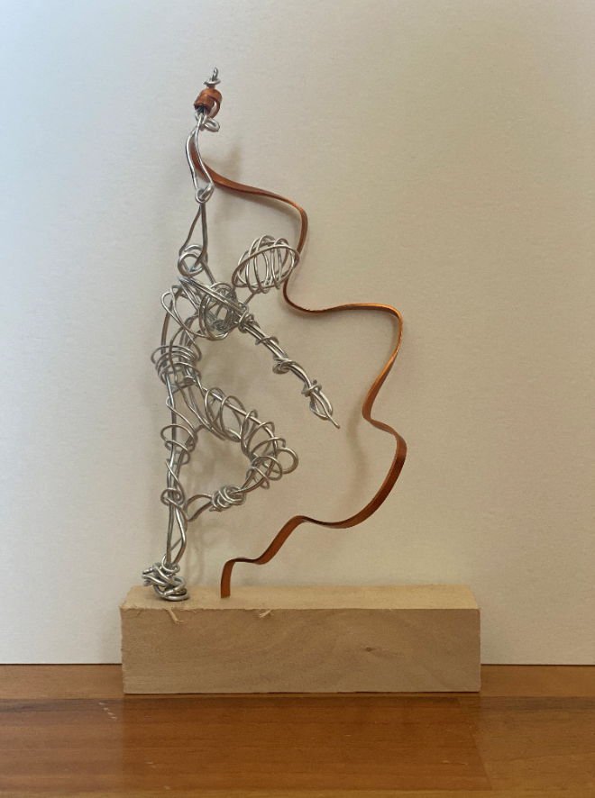 Silver dancer with gold ribbon on wooden block stand (10x6x18cm)