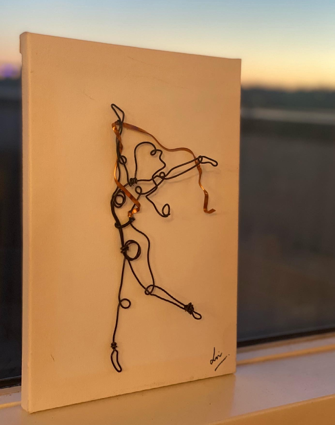 Black wire dancer with gold ribbon on white canvas(21x2x30cm)