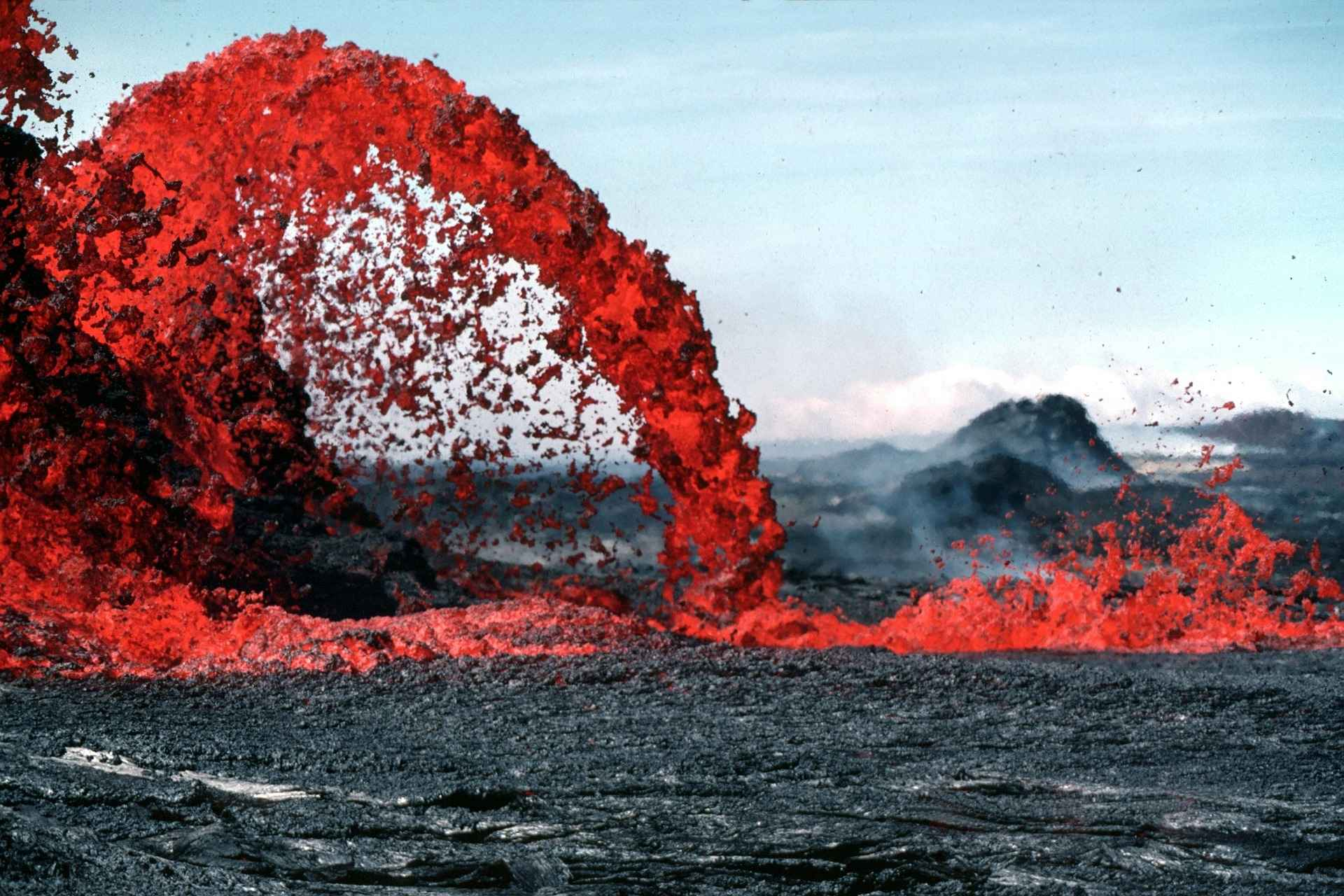 red hot spewing magma bursting volcano
