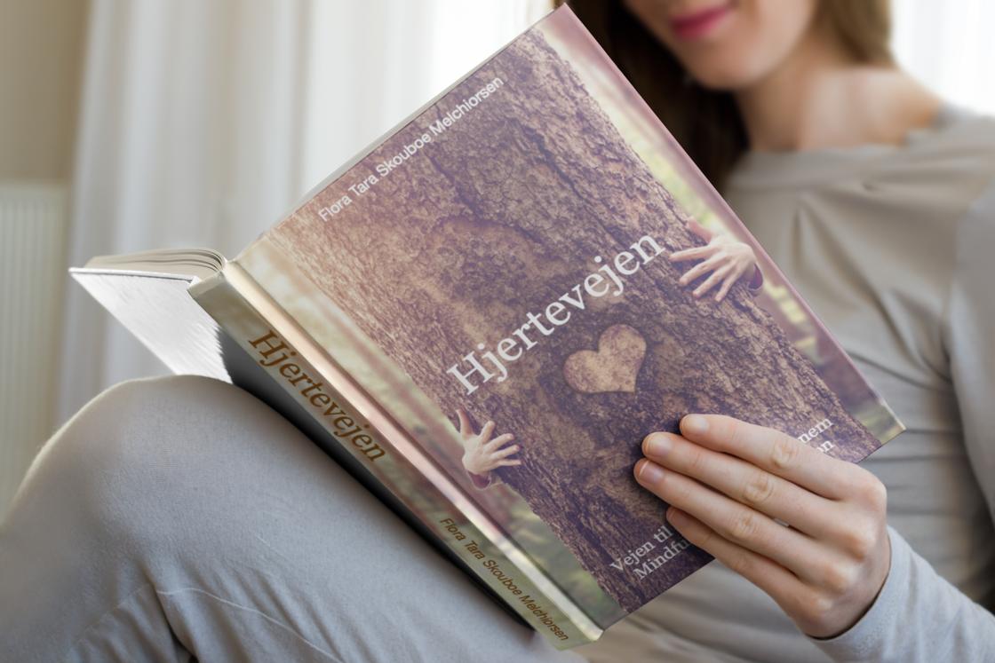 hardcover-book-mockup-of-a-woman-reading-3409-el1
